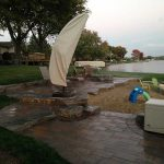 Stone and paver patio added to a beach front property in Commerce MI