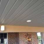 Trex installed on the ceiling of an outdoor living space in Novi MI