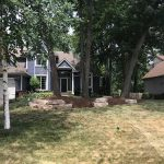 A home with clean flower beds lined with stone borders in Commerce MI