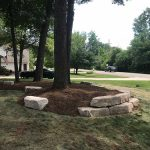Mulch your flower beds to prevent weed growth and keep your yard looking its best in Commerce MI