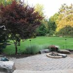 Paver patio with fire pit and outdoor shower in South Lyon MI