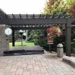 Place your hot tub on a custom patio and create a relaxing environment in Northville MI