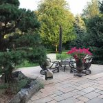 Make your patio more inviting with potted plants and furniture in Northville MI