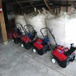 Snow blower and bags of salt ready for the winter snow in Novi MI
