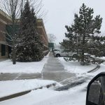 Commercial sidewalks that have been cleared of snow in South Lyon MI