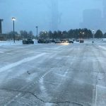 A parking lot that has been cleared of snow by Images Landscaping in Commerce MI