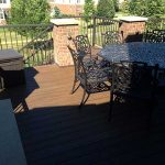 A completed deck with outdoor furniture in Northville MI