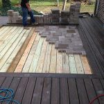 A patio inset being installed in South Lyon MI