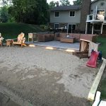 A beautiful paver patio with exterior lighting installed on a beach front property in Commerce MI