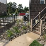 Use stone as a landscaping material to prevent weed growth in flower beds in Commerce MI