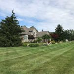 A beautiful yard with a well maintained flower beds in South Lyon MI