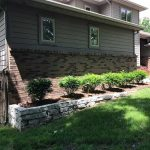 Retaining wall stones can be used to create flower beds on homes with a sloping yard in Commerce MI