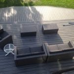 An aerial view of a completed deck with outdoor furniture in Novi MI