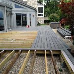A deck that is in the process of being installed in South Lyon MI
