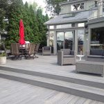 Custom built grey deck on a home in Northville MI