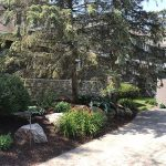 A well landscaped yard created by Images Landscaping in Commerce MI