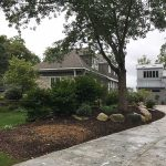 Add mulch to your flower beds for a clean look in Novi MI