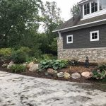 Well maintained flower beds add to the beauty and value of your home in South Lyon MI