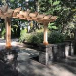 A small pergola to mark the entrance of an outdoor living space in West Bloomfield MI