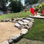 Stone steps to create a natural stairway to the beach in South Lyon MI