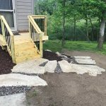 A newly built porch leading to stone steps in Novi MI