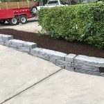 Use stone to create flower beds along your driveway in Novi MI