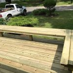 A custom built bench on a front deck in Commerce MI