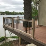 Custom deck built around a tree growing in Northville MI