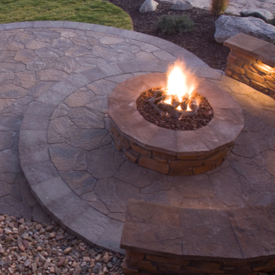 Enhance your living space with a stone fire pit and patio in Commerce MI