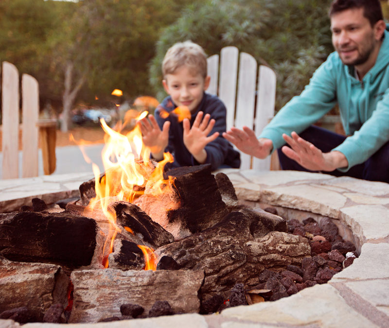 Father and son around campfire