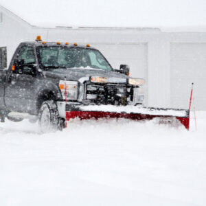 truck with plow removing snow