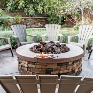 fire pit on patio surrounded by chairs